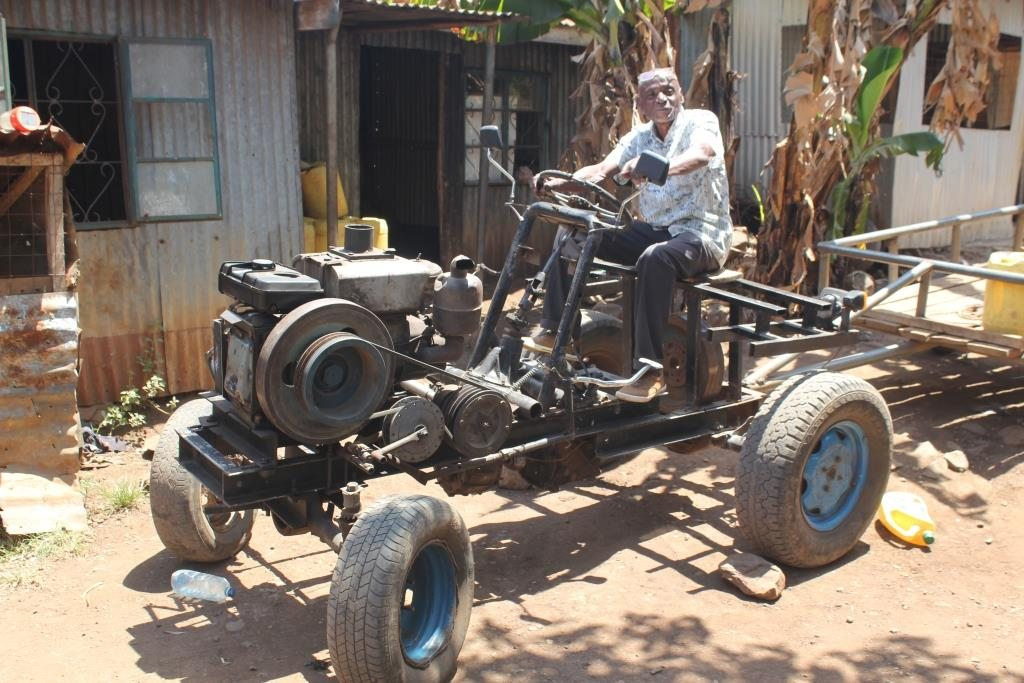 Chrispine Adet's self-made tractor